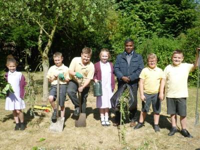 Father Louis Visits The Gardening After School Club